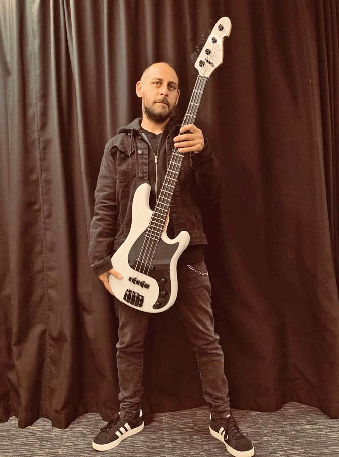 image of Mendez with his signature bass